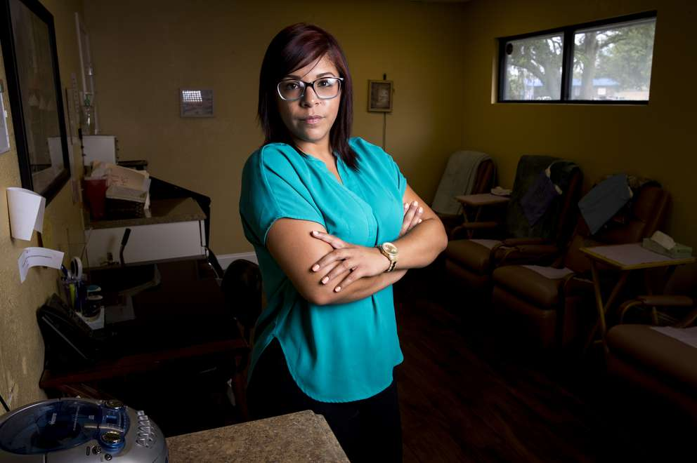 Nurse Michelle Mejia tends to patients in the clinic's recovery room as they shake off the sedation. She likes to help bring them out of whatever dark cloud hangs over them, saying,