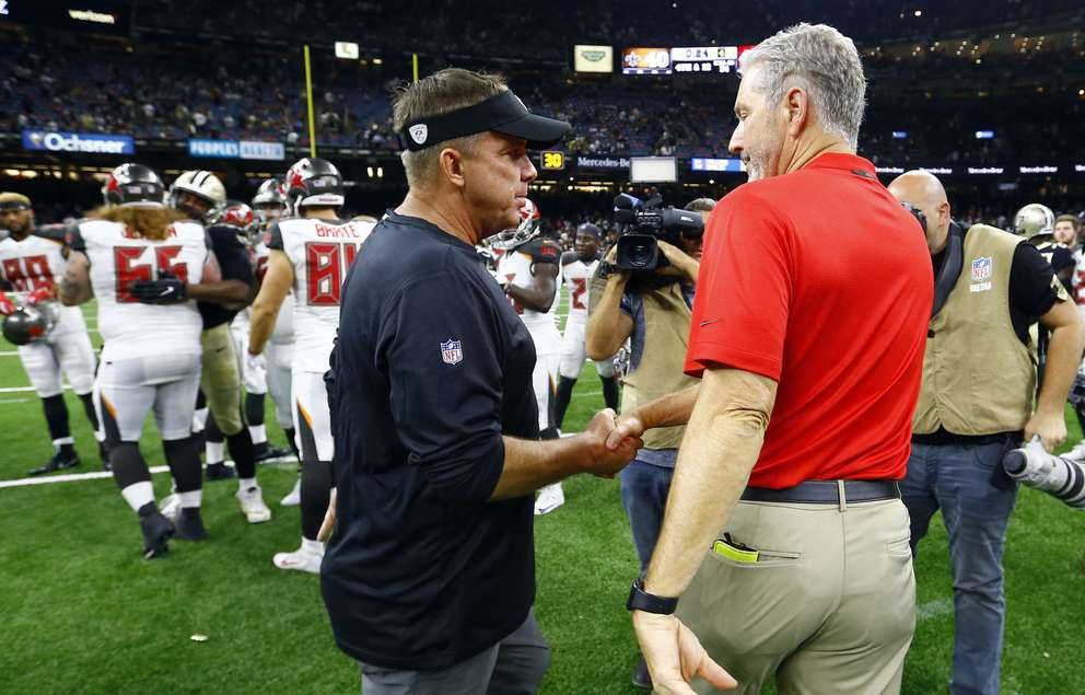 Saints head coach Sean Payton, left, shakes hands with Bucs coach Dirk Koetter, right, after Tampa Bay won the first meeting between the teams, 48-40, in September in New Orleans. [AP Photo/Butch Dill]