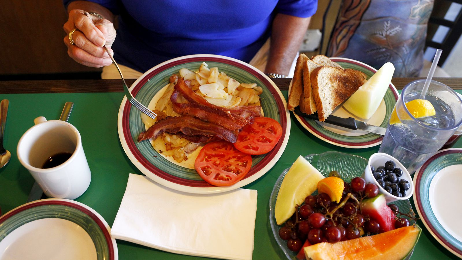Rye toast, bacon, tomatoes, potatoes and fresh fruit at the Frog Pond restaurant.
