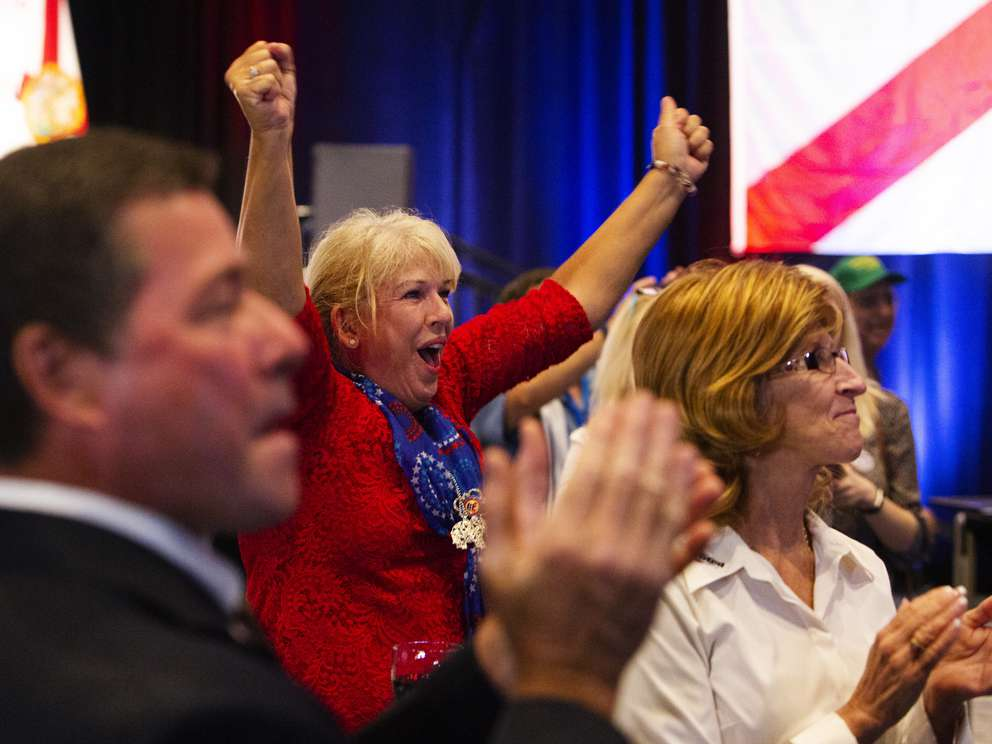 Debbi Stolte, 60, of Altamonte Springs, cheers after Ron DeSantis victory was announced during the Ron DeSantis for Governor Election Night Party in the Sebastian Ballroom at the Rosen Shingle Creek on Aug. 28 in Orlando. (TAILYR IRVINE | Times)