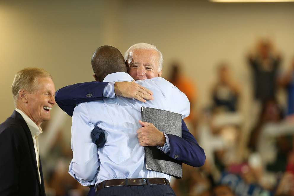 OCTAVIO JONES | Times U.S. Sen. Bill Nelson, left, looks on as former Vice-President Joe Biden, right, greets Florida Gubernatorial Democratic candidate Andrew Gillum before giving a speech during the Florida Democratic Party rally held at the University of South Florida in Tampa, Florida on Monday, October 22, 2018.