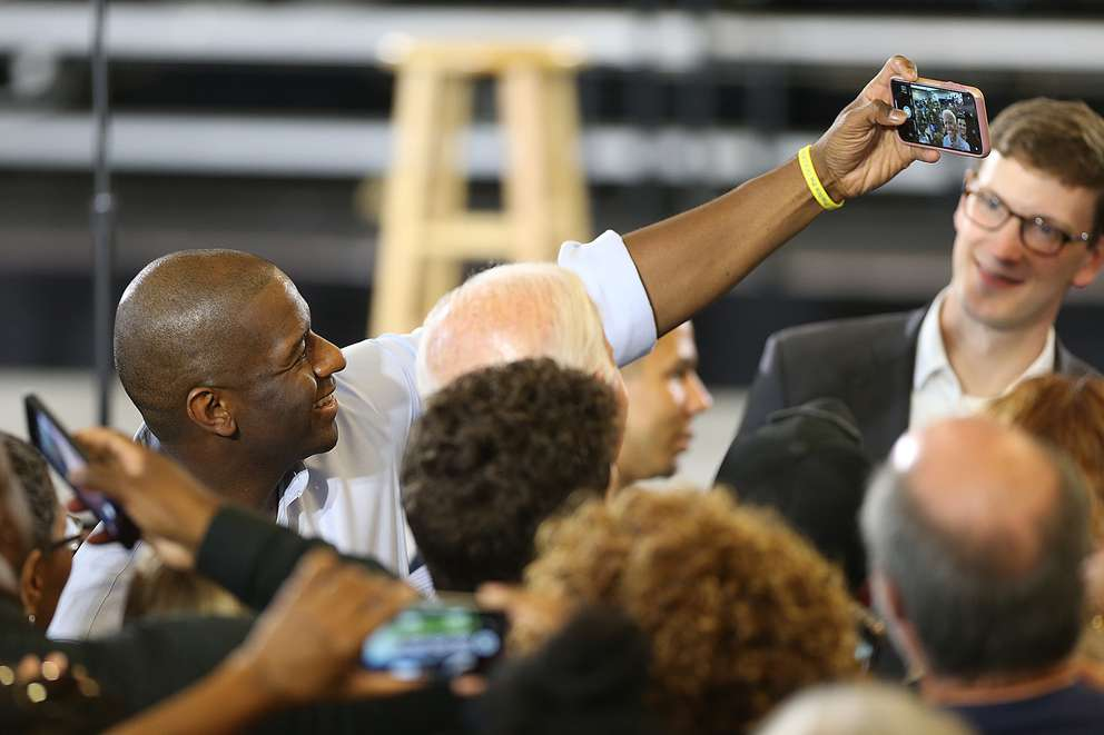 OCTAVIO JONES | TimesFlorida Gubernatorial Democratic candidate Andrew Gillum takes selfies with the crowd after giving a speech during the Florida Democratic Party rally held at the University of South Florida in Tampa, Florida on Monday, October 22, 2018.