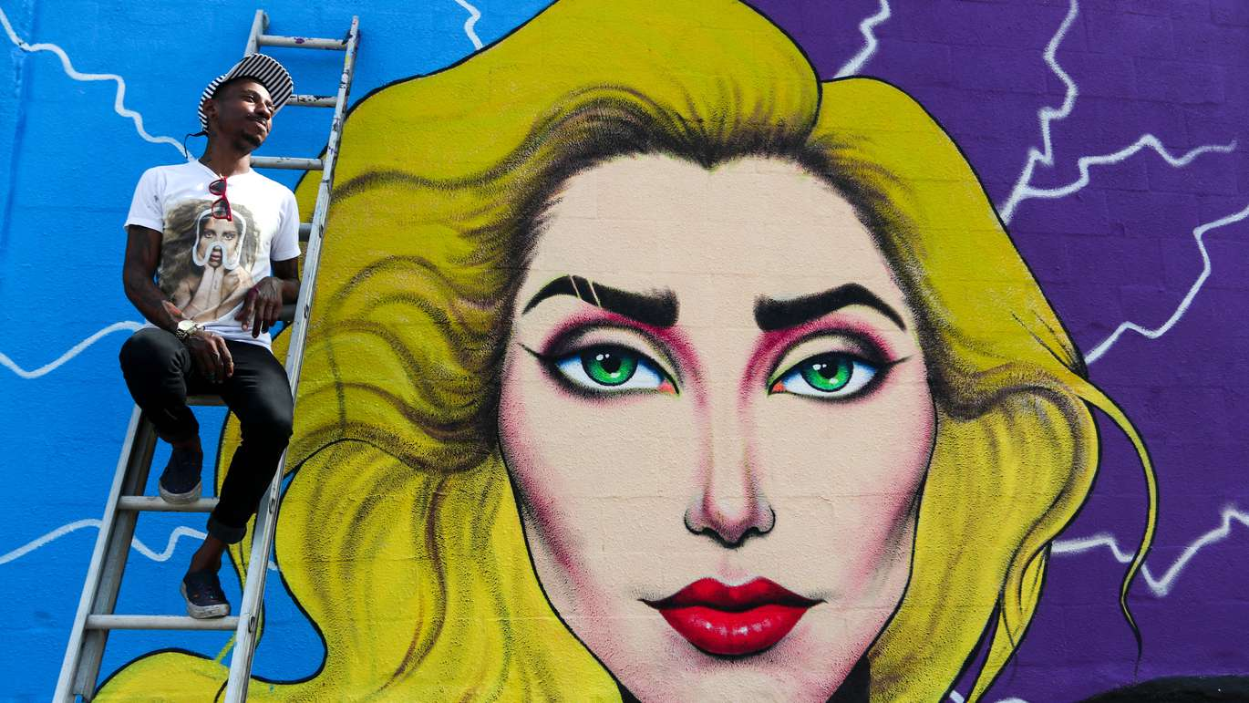 Tampa muralist Cam Parker, 33, poses for a portrait in front of his mural of Lady Gaga in the 1700 block of N Franklin Street in Tampa, Fla., on Thursday, November 9, 2017. Parker hopes to catch the pop star's attention and that she will take a selfie with the mural when she comes to Tampa in concert December 1, 2017.