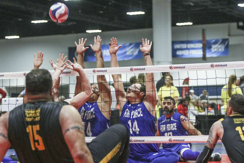 Senior Airmain Joseph A. Pate, number 14, tries to block the ball during the sitting volleyball match between airfare and army on Thursday, June 27, in Tampa. [ANGELIQUE HERRING   Times]
