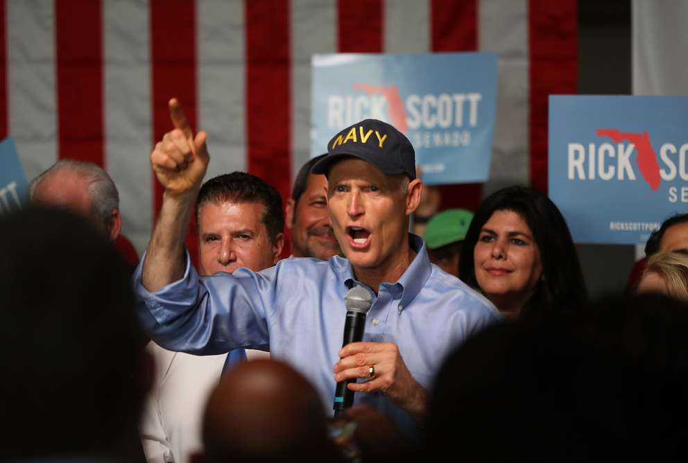Florida Gov. Rick Scott addresses supporters as he holds a Senate campaign rally at the Interstate Beverage Corp. on April 10 in Hialeah. (Photo by Joe Raedle/Getty Images)