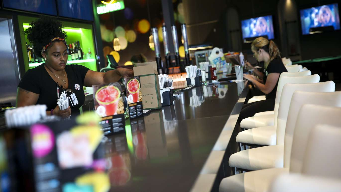 WILL VRAGOVIC   Times Bartender Calatha Spruill, 25, fills containers of straws during a practice day where servers took turns testing menu items and procedures at Dave & Buster's in Brandon, Fla. on Monday, Oct. 23, 2017.