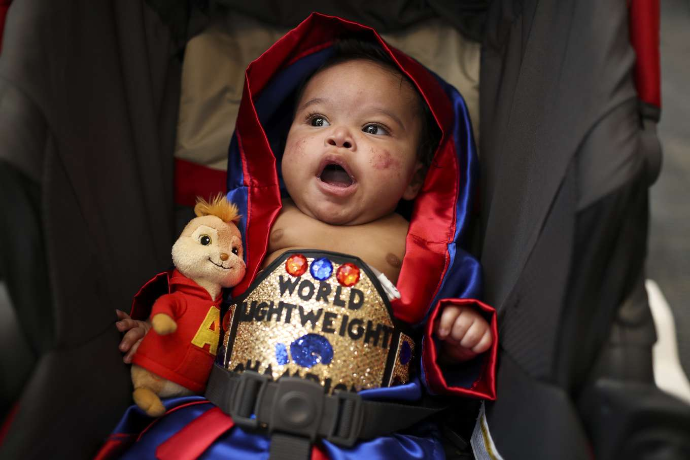 Elijah Weaver, 5 1/2 months, yawns in his stroller during a Halloween Parade for children at St. Joseph's Hospital, in Tampa, Fla. on October 31, 2017. Costumed pediatric patients trick or treated through the hospital campus, stopping along the parade route to pick up candy and gifts.