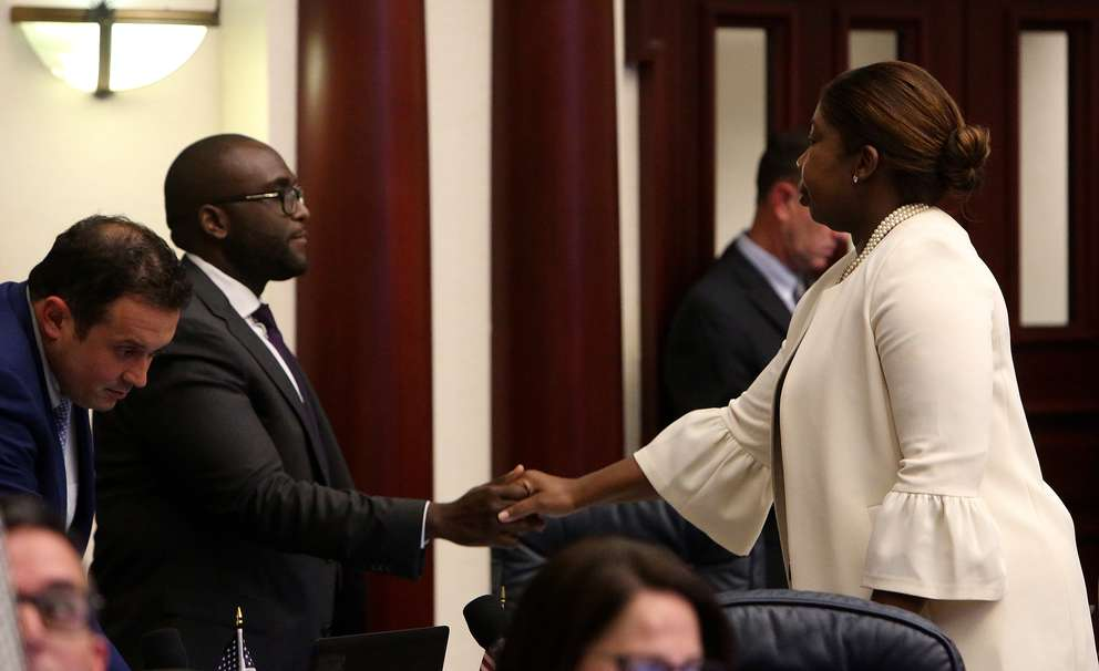 Rep. Shevrin Jones, -D, West Park, gets a hand shake from Rep. Kamia Brown, D-Ocoee, after his amendment failed during debate on a bill that would arm teachers in schools. SCOTT KEELER | Times