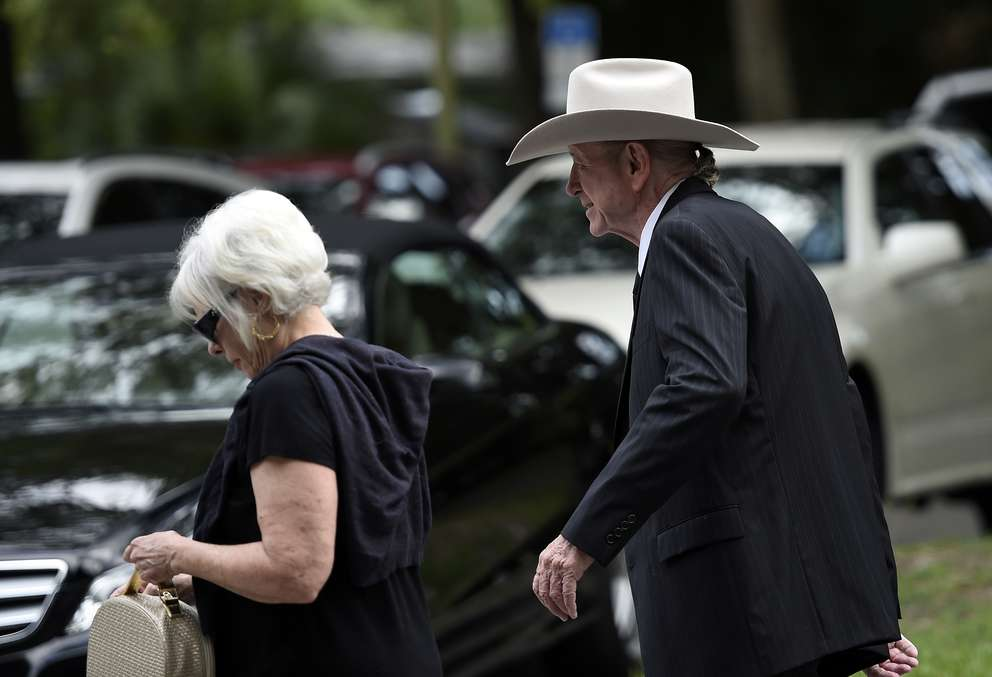 Dory Funk Jr., right, arrives with an unidentified woman, to the funeral of Virgil Runnels Jr. the professional wrestler know as Dusty Rhodes, in Tampa. [Times files (2015)]