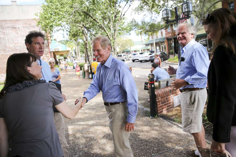 Sen. Bill Nelson shakes hands with Paula Ferreira in Fernandina Beach on Sept. 1. At age 74, Nelson is one of the most physically fit senators at the Capitol. (WILL VRAGOVIC | Times)