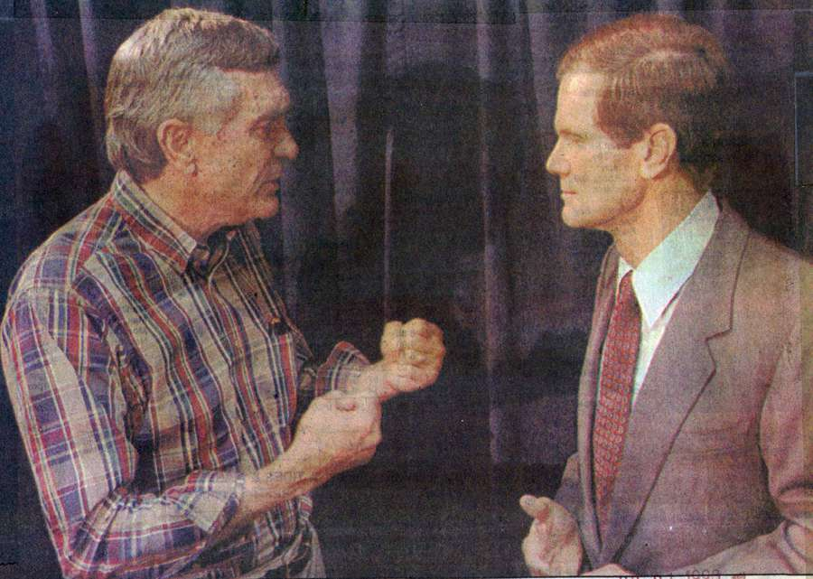 Gubernatorial candidate Lawton Chiles clenches his fists as he berates Democratic opponent Bill Nelson about smear tactics on July 21, 1990.
