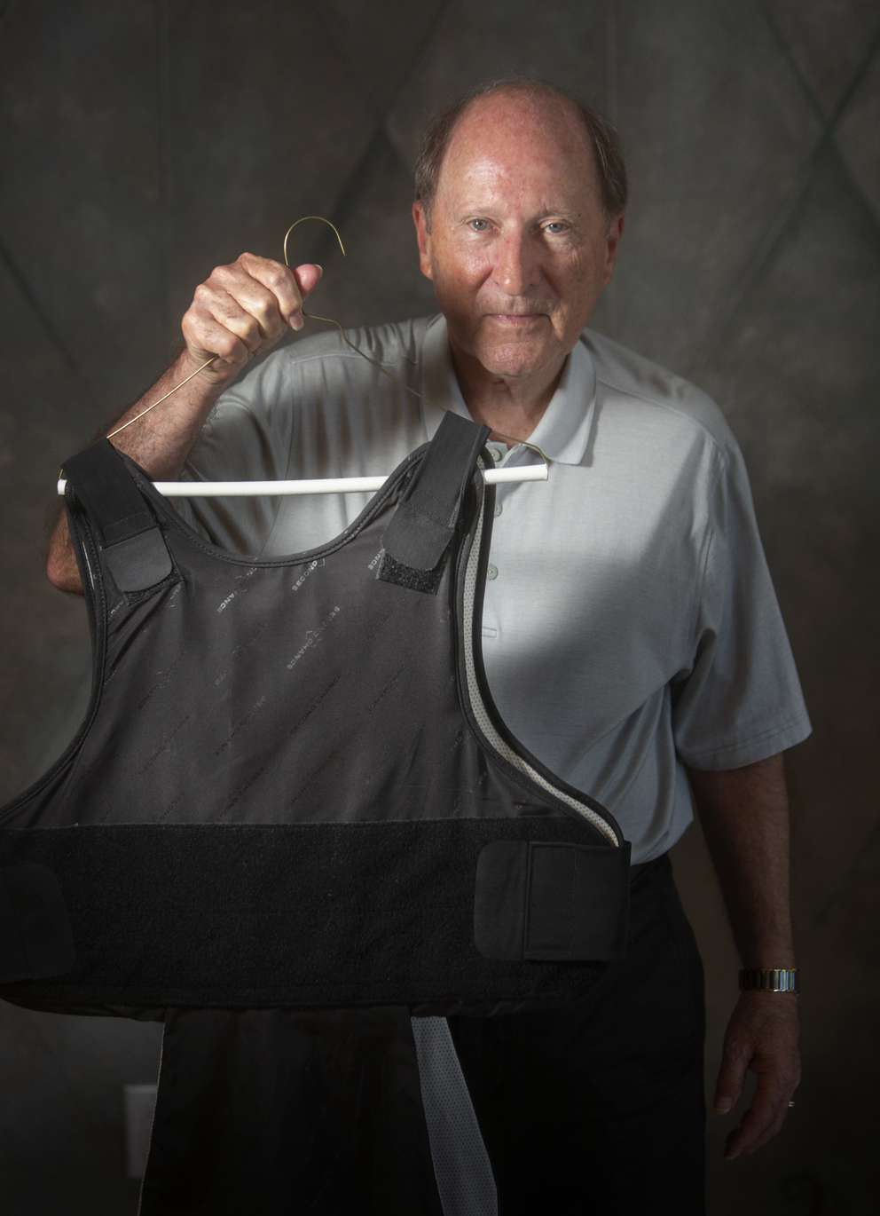 Greer poses with the bulletproof vest he wore while presiding over the Schiavo case. [JOHN PENDYGRAFT | Times]