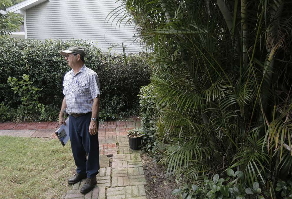 Richard Bailey, a forester and master arborist, consult with a client Norman De Lapouyade at his home on the care of his palm trees in south Tampa on Thursday, June 13, 2019. OCTAVIO JONES | Times