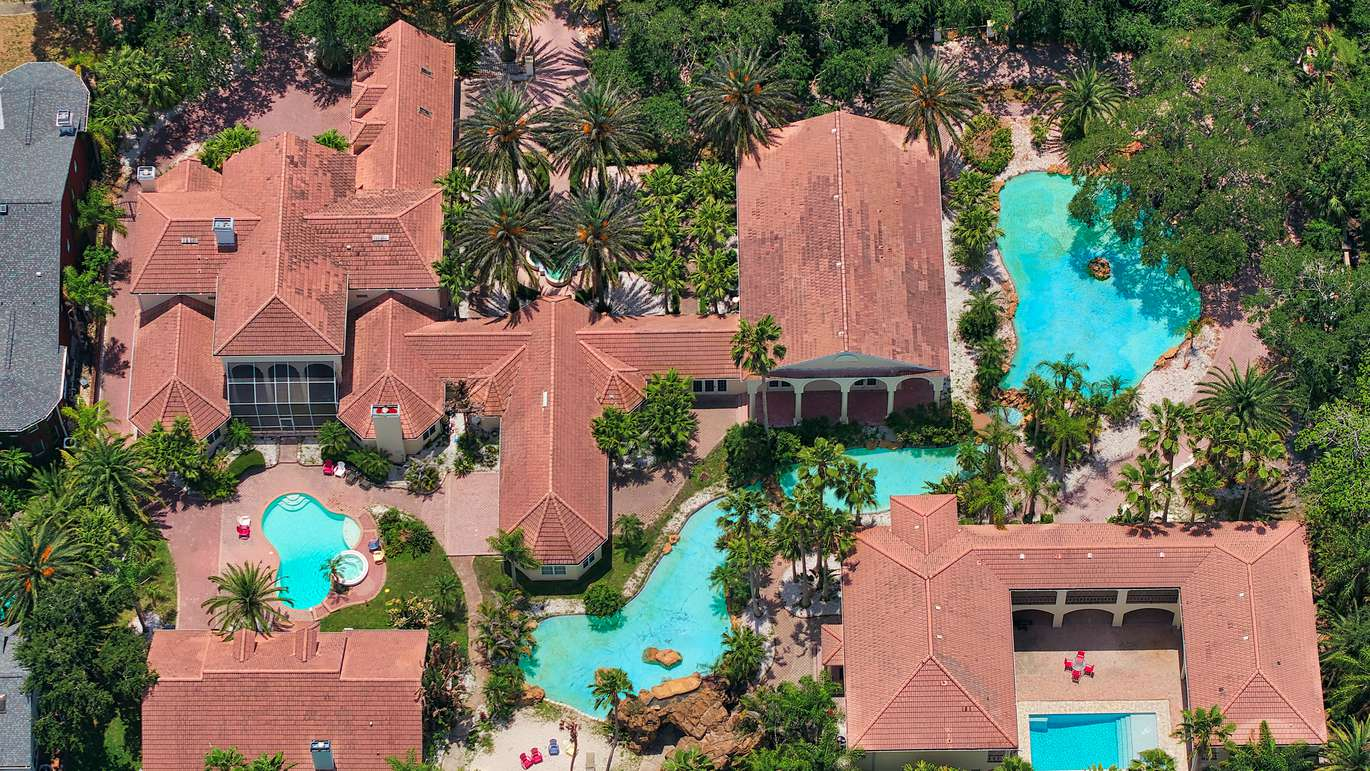 This three-house complex in a gated community in Clearwater comes with its own lagoon and waterfall.