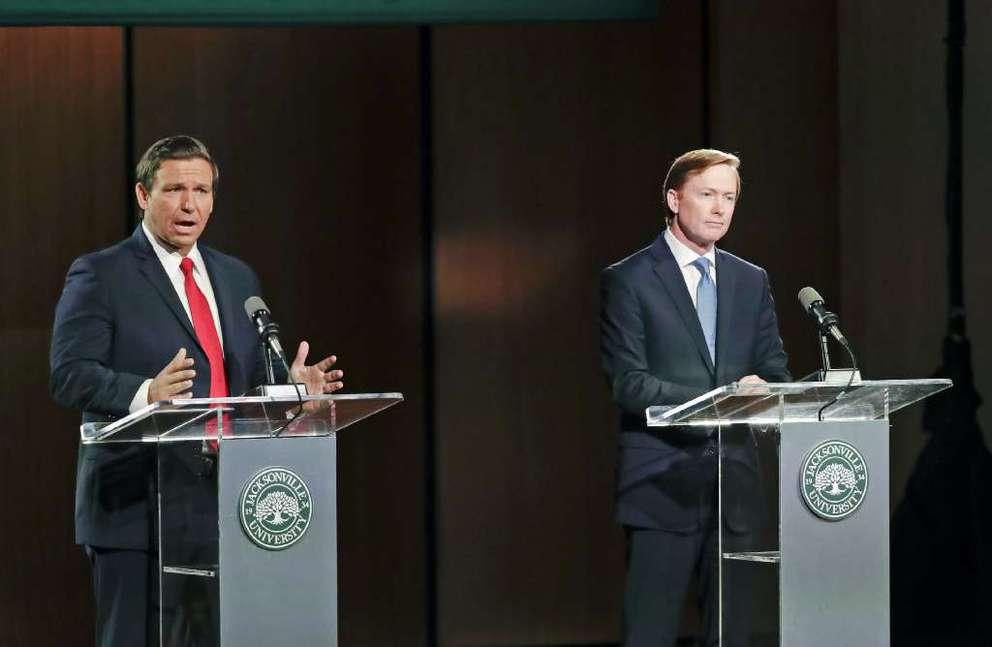Republican gubernatorial candidate Ron DeSantis (left) debates Adam Putnam in Wednesday's second and final debate at Jacksonville University. [AP | John Raoux]