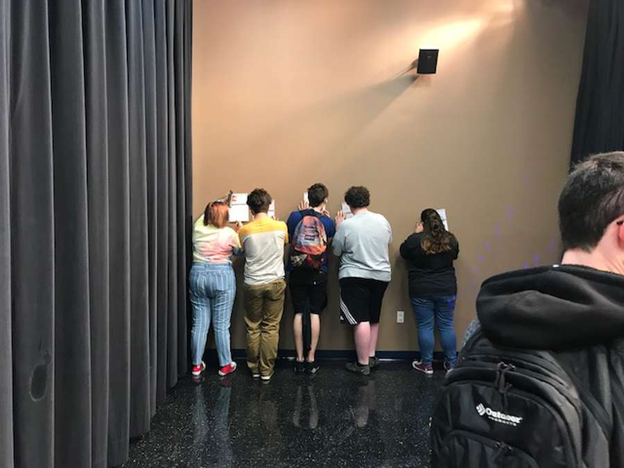 Students at a Pasco County high school register to vote during a recent registration drive. They ran out of table space and had to fill out the forms on the wall. Courtesy of Pasco County Supervisor of Elections.