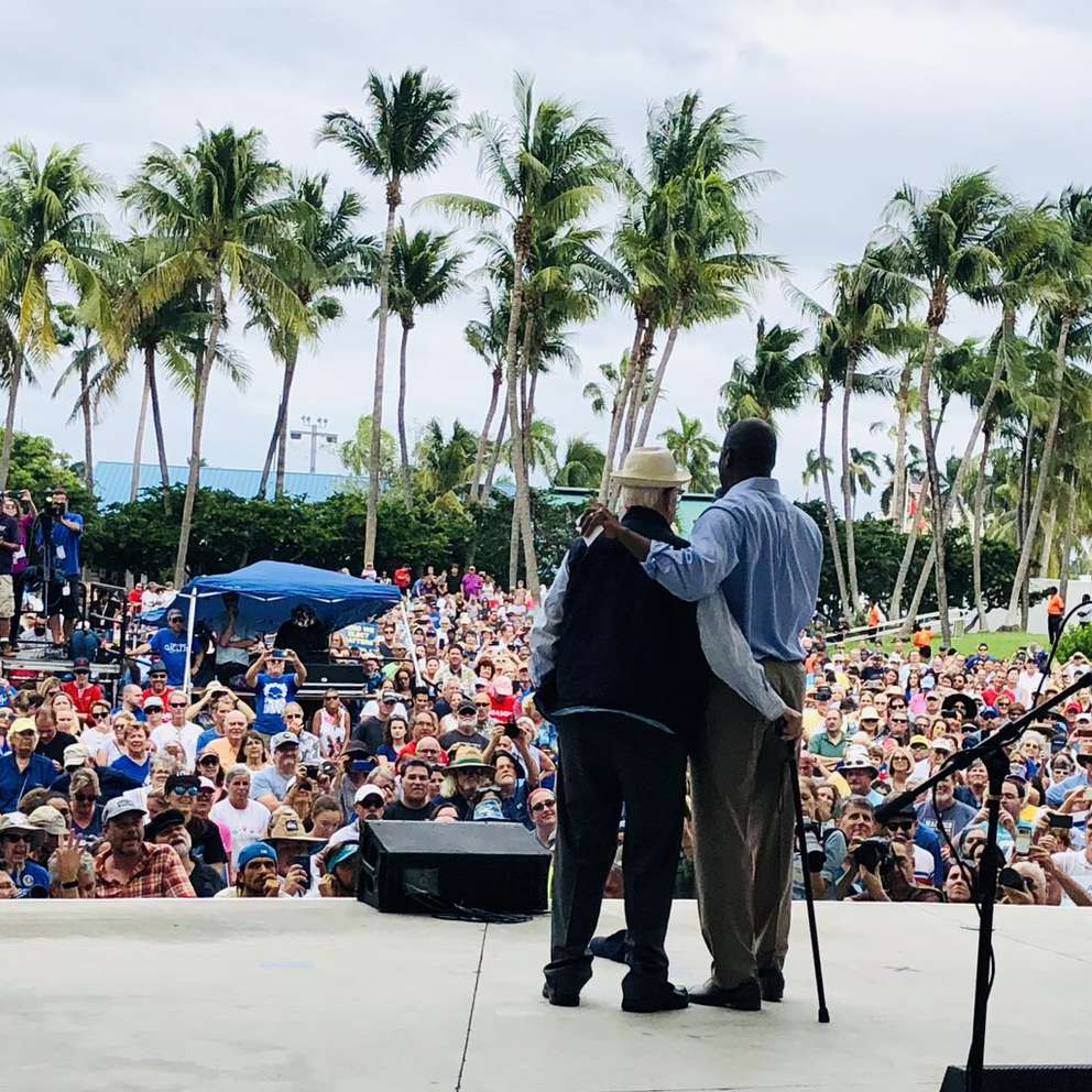 Television writer and producer Norman Lear embraces Andrew Gillum on stage at Saturday's rally in West Palm Beach. (Courtesy of the Andrew Gillum campaign)