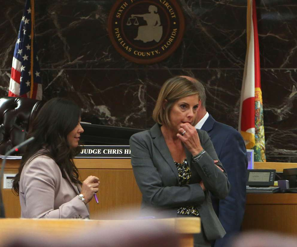Assistant Public Defenders Jane McNeill, right, and Jessica Manuele, left, leave a bench conference on Tuesday. McNeill is conducting the cross-examination of psychologist Peter Bursten. [SCOTT KEELER | Times]