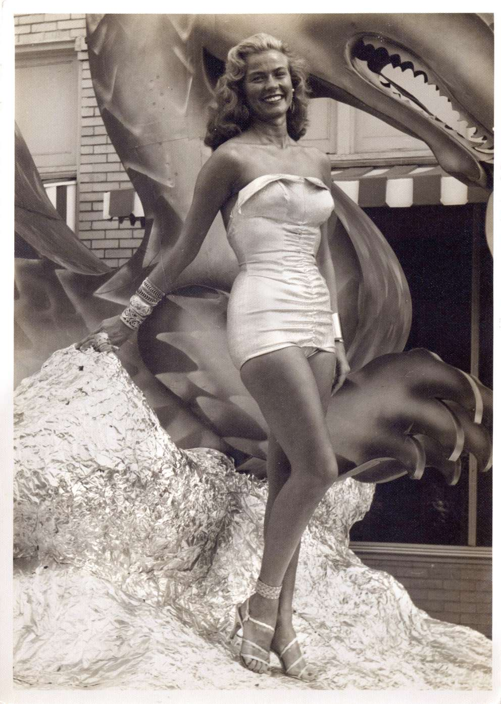 Joanne Ross stands by a Gasparilla dragon float in 1951. She was known for her role as the Gasparilla Parade's Mystery Blonde during the 1950's and 60's as the Gasparilla Parade's Mystery Blond. [Photo provided by Joanne Ross | Times archives]