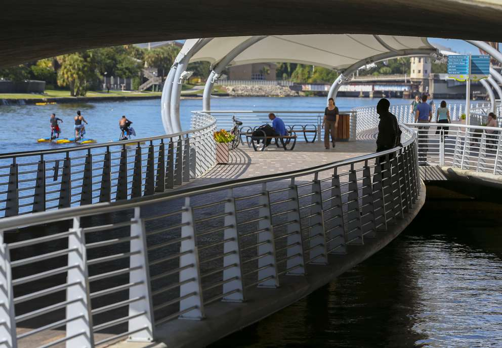 Pedestrians and water bike riders enjoy the Riverwalk at the John F. Kennedy Boulevard bridge on Nov. 7, 2018, in Tampa. (CHRIS URSO | Times)