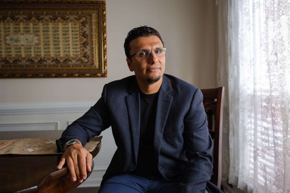 Heval Kelli at his home in Atlanta. The cardiologist, a Syrian Kurd whose family was granted asylum in the United States in 2001, offers himself as an ambassador for Islam and for refugees. [Photo for The Washington Post by Kevin D. Liles]
