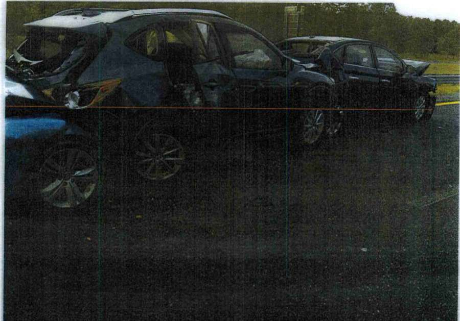 This photo from Hillsborough County court records shows the crash scene on Sept. 15, 2016, when a Hyundai sedan, left, slammed into the back of Logan and Brooke Scherer's Madza CX-5. The Scherers' son Logan, who was sitting in the back, died at the scene. [Hillsborough County Clerk of Court]