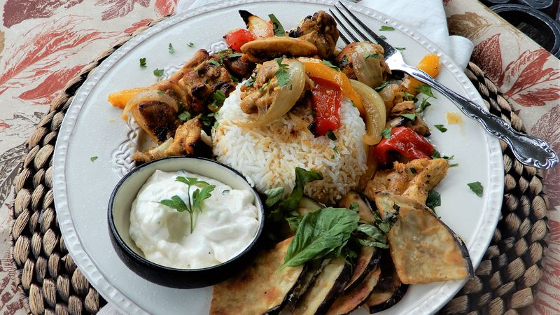 A recipe for chicken shawarma with sweet onions and red peppers