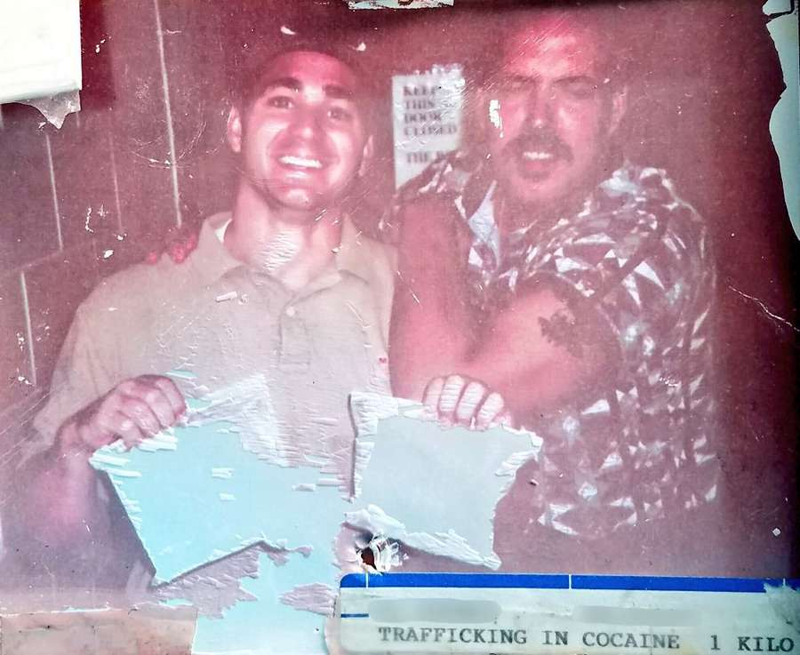 "A baby-faced Chad Chronister and his then-partner Miguel Diaz show off a kilo of cocaine seized during a bust in 1997, when the two men were narcotics detectives. Chronister has worked in nearly every part of the Sheriff's Office and his quick rise earned him the nickname ""golden boy."" [Twitter]"