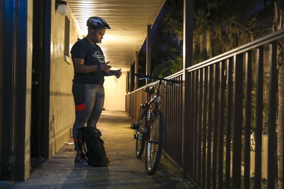 Erieka Smith prepares to ride her bike to work Tuesday, Oct. 30, 2018 in Tampa. Smith commutes by bike approximately seven miles from her home in the University area to her office at the Salvation Army in Tampa.