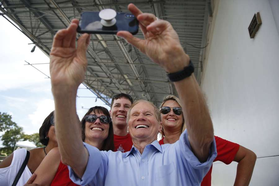 Sen. Bill Nelson, D-Fla., takes a selfie with public school educators during a rally on Aug. 19 in Miami Gardens. (AP Photo/Brynn Anderson)