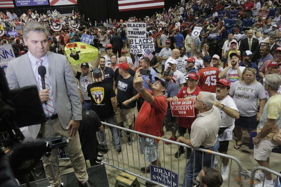 Supporters of President Donald Trump heckle CNN Jim Acosta, left, during a Trump rally at the Florida State Fairgrounds in Tampa on Tuesday. (OCTAVIO JONES | Times)