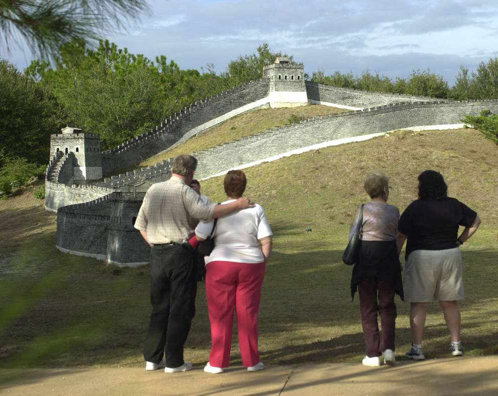 Visitors view a replica of the Great Wall of China at Splendid China on Tuesday, Dec. 30, 2003. The park closed the next day. [Peter Cosgrove | AP Photo]