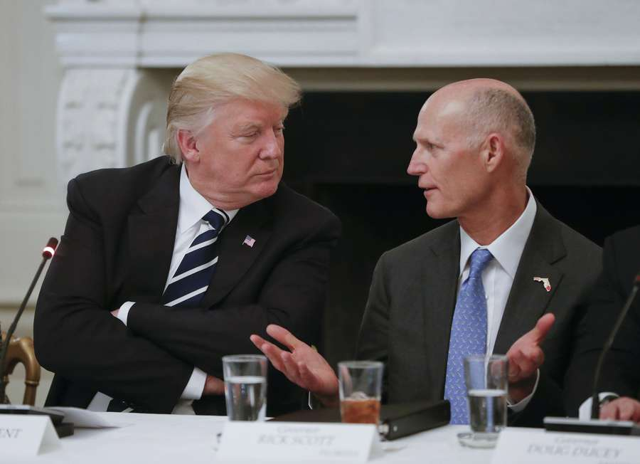 President Donald Trump listens to Florida Gov. Rick Scott, right, during a meeting with U.S. Mayors and Governors for an Infrastructure Summit in the State Dinning Room of the White House in Washington, Thursday, June 8, 2017. (AP Photo/Pablo Martinez Monsivais)
