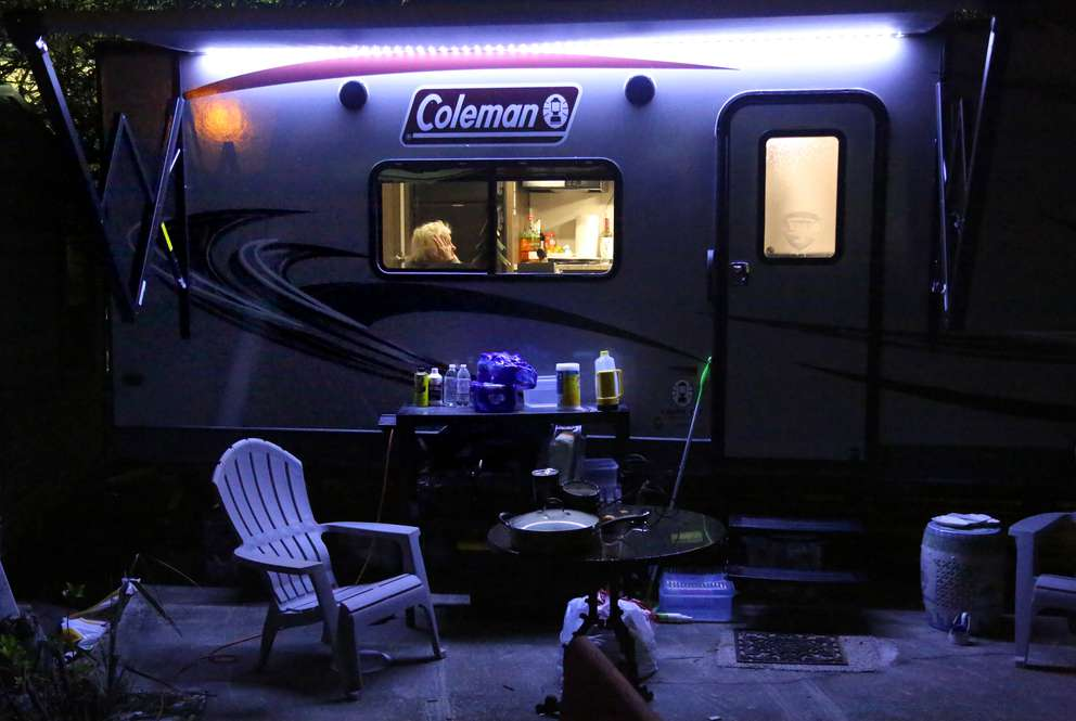 Peggy Wood, owner of the Driftwood Inn, sits in her camper in December. DOUGLAS R. CLIFFORD | Times