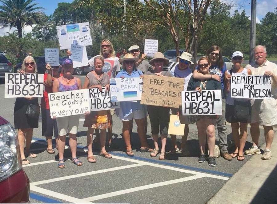 A Small Group Of Walton County Democrats And Beach Access Advocates Waited In Vain For Gov Rick Scott Sunday Santa Rosa Special To The Times