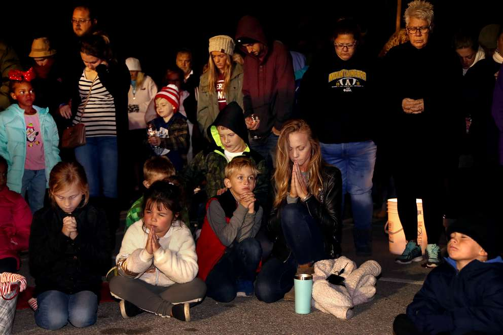 Residents of Mexico Beach observe a prayer during the annual Christmas tree lighting. (DOUGLAS R. CLIFFORD | Times)