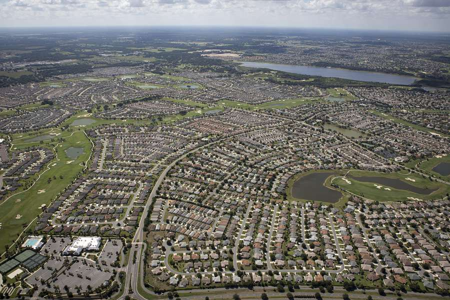 An aerial view of The Villages retirement community in Central Florida taken June 27, 2015. At 34 square miles and still expanding, The Villages is already bigger than Manhattan. It took root in the 1960s and has now gobbled up more than 20,000 acres of pastureland, hay fields and vegetable farms in three rural counties, dominating in size and population most of the historic small towns. (REUTERS/Carlo Allegri)