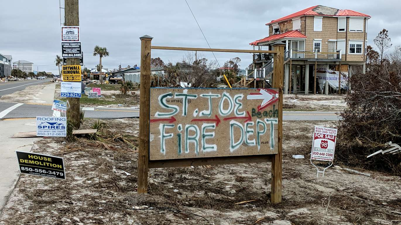 Signs for contractors, and the fire department, line a corner on U.S. 98 at St. Joe Beach. (DOUGLAS R. CLIFFORD | Times)