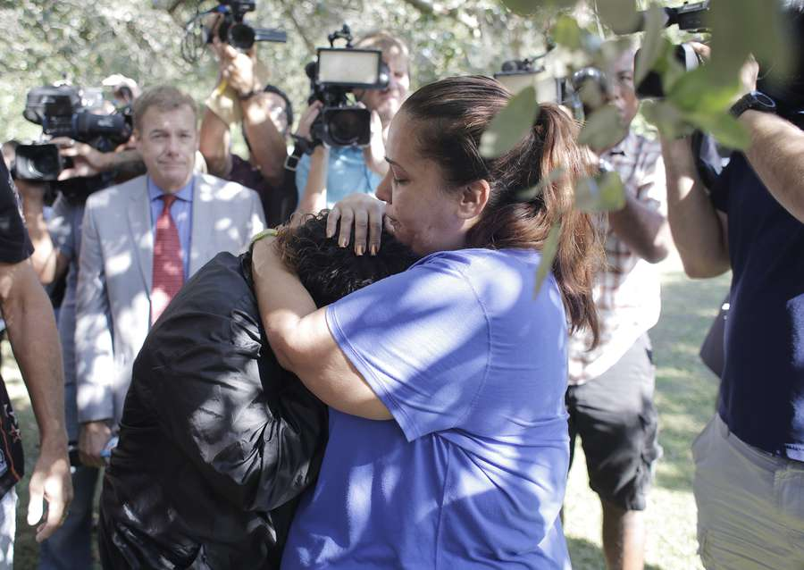 Karen Naiboa, left, the sister of Anthony Naiboa is consoled by her mother Maria Rodriguez, right, after a news conference given by Tampa Mayor Bob Buckhorn and Tampa Police Chief Brian Dugan at the Seminole Heights Garden Center in Tampa on Wednesday, Nov. 29, 2017. Anthony Naiboa was one of four victims that was murdered during the string of the Seminole Heights shootings. [OCTAVIO JONES | Times]
