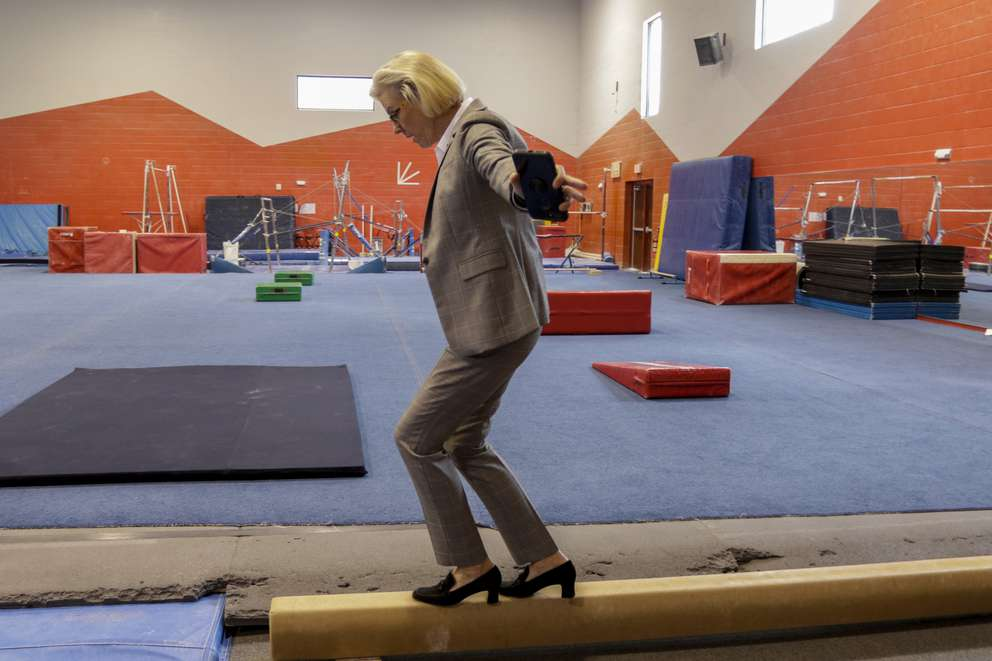 MARTHA ASENCIO-RHINE   Times Tampa Mayor Jane Castor takes a few steps on the balance beam while visiting the Wayne C. Papy Center in Tampa, May 17, 2019.