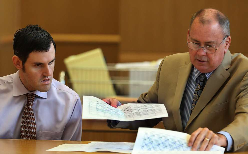 John Jonchuck and Assistant Public Defender Greg Williams look over a seating chart with names of prospective jurors on the fourth day of jury selection. [SCOTT KEELER | Times]