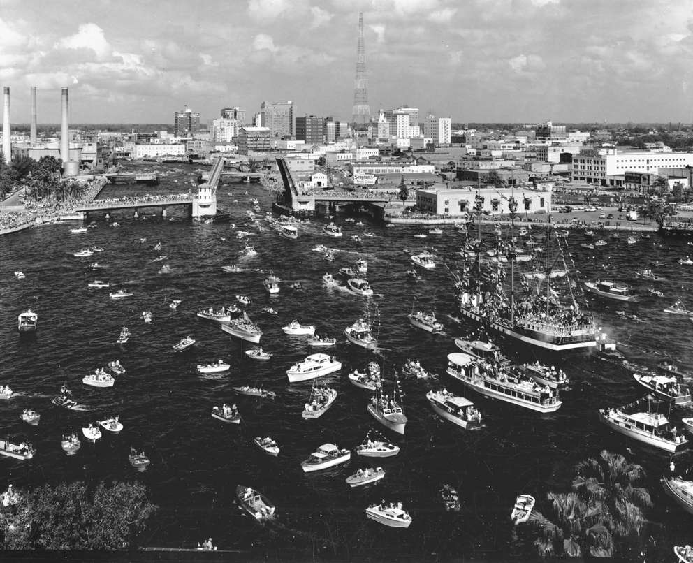 Boats surrounding Gasparilla ship head toward the Platt Street Bridge in 1959. Photo taken from Tampa General Hospital, 1959. [Courtesy, Tampa-Hillsborough County Public Library System]