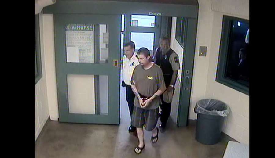 Michael Drejka is led into the booking area of the Pinellas County Jail on Aug. 13. [Photo courtesy Pinellas County Sheriff's Office]
