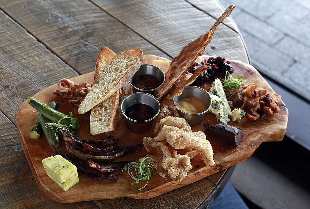 The Cheese and Charcuterie Accoutrement at The Mill in St. Petersburg includes mustard, local honeycomb, Florida orange marmalade, baby zucchini pickles, malted rye mustard and a bitter chocolate chunk. Times (2015)