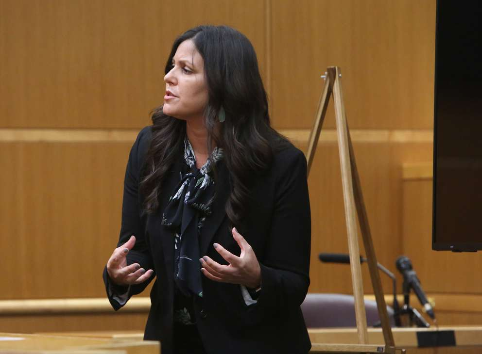 Public defender Jessica Manuele uses her hands to show how defendant John Jonchuck picked up his daughter Phoebe before dropping her into Tampa Bay. SCOTT KEELER | Times