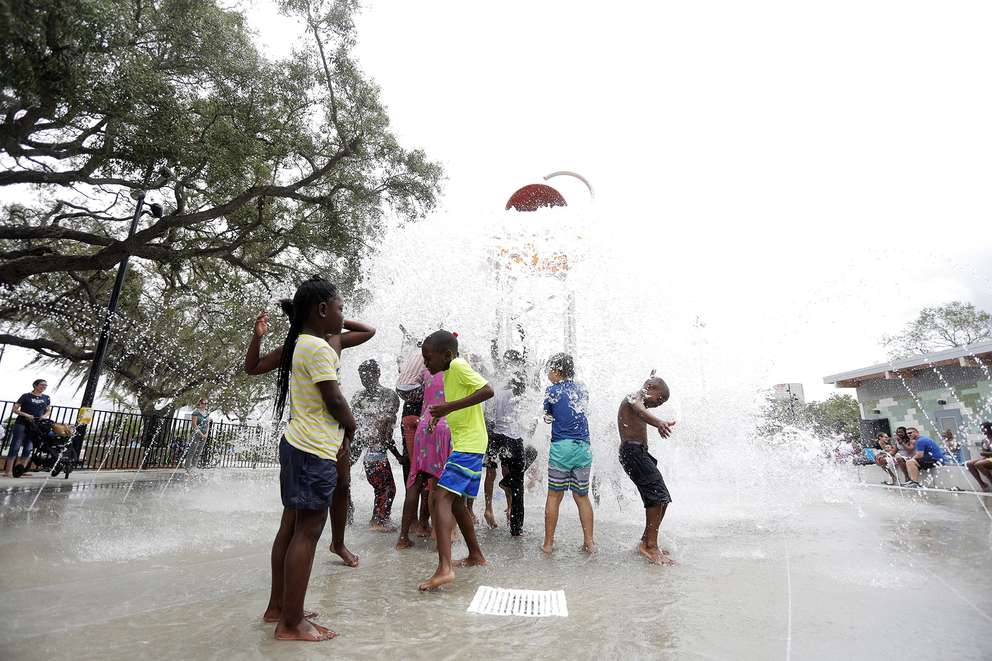 Kids enjoy the splash pad at the Julian B. Lane Riverfront Park in downtown Tampa on May 28, 2018. (OCTAVIO JONES | Times)