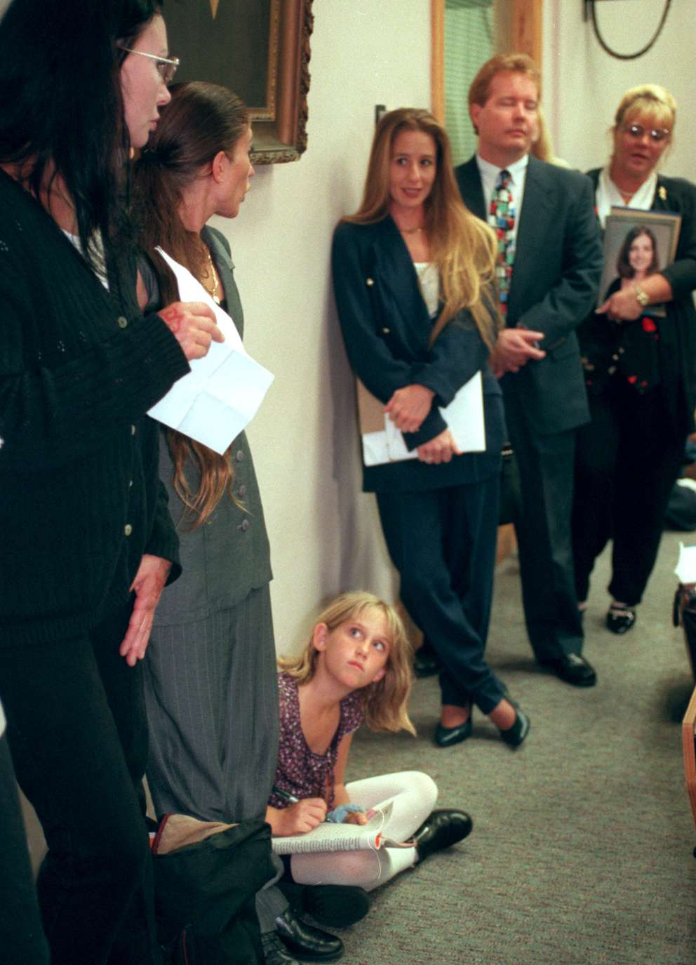 Dancers and their families gather along the wall waiting their turn to speak to the Tampa City Council. The public hearing was held to discuss a proposed new lap dancing ordinance under consideration by the City of Tampa. The dancers said the lap dance ban would spread hardship, not stem the spread of lawlessness and disease. Times (1999)