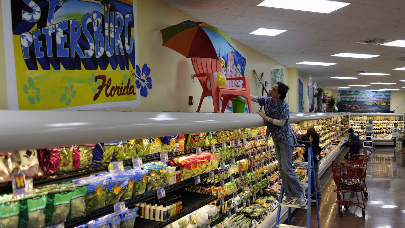 Amy Armstrong arranged store decorations inside ahead of the grand opening. Trader Joe's is opening its St Petersburg location Friday along 4th Street N. [JAY CONNER | Times]