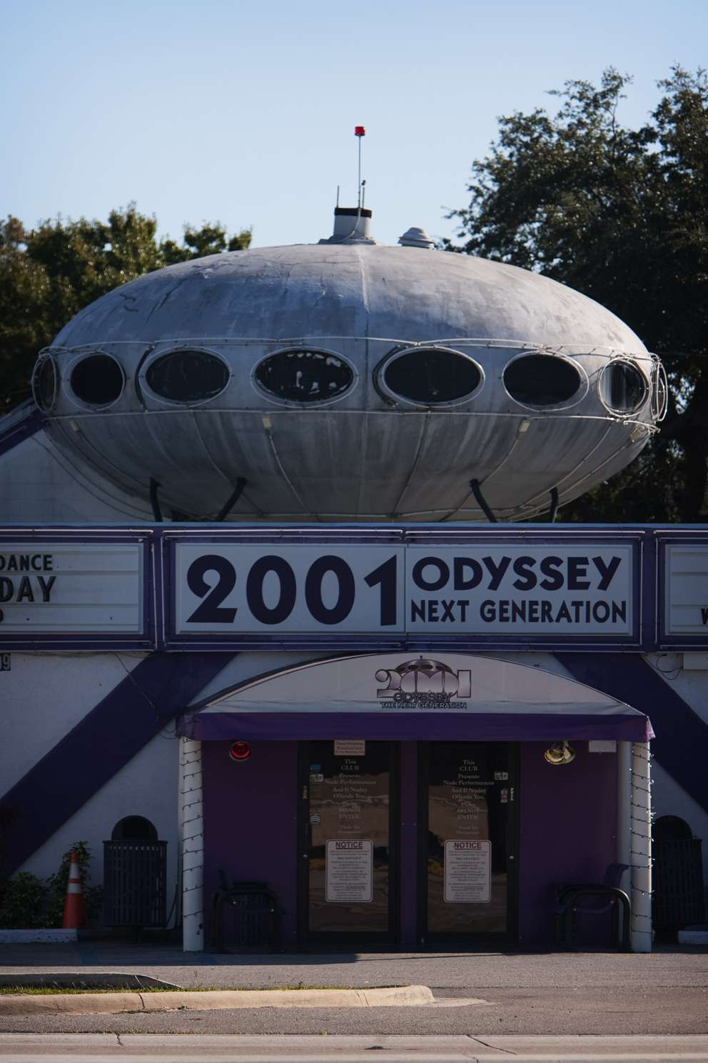 2001 Odyssey is a Tampa strip club that has taken on landmark status because of the orb that sits atop its roof. Times.