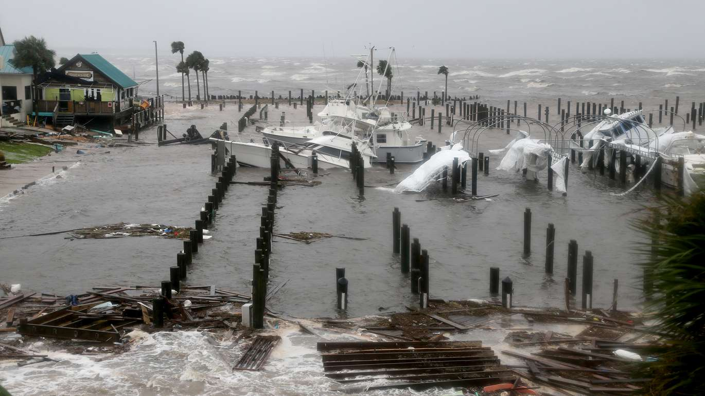 Storm Surge retreats from inland areas, foreground, where boats lay sunk and damaged at the Port St. Joe Marina in the Florida Panhandle on Wednesday (10/10/18) after Hurricane Michael made landfall near Mexico Beach. (Douglas R. Clifford, Times)